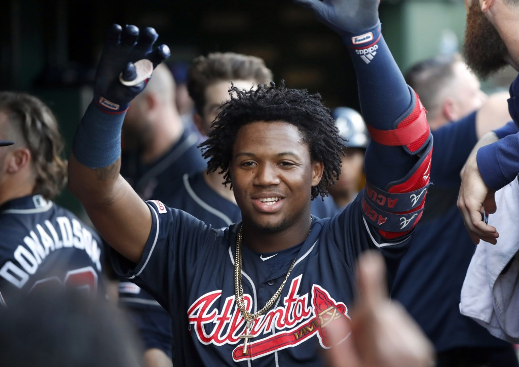 Atlanta Braves' Ronald Acuna Jr. celebrates his home run off Chicago Cubs starting pitcher Adbert Alzolay during the first inning of a baseball game, ...