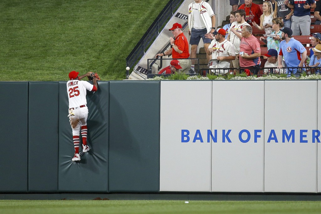 St. Louis Cardinals right fielder Dexter Fowler is unable to catch a home run hit by Oakland Athletics' Marcus Semien during the fifth inning of a bas...