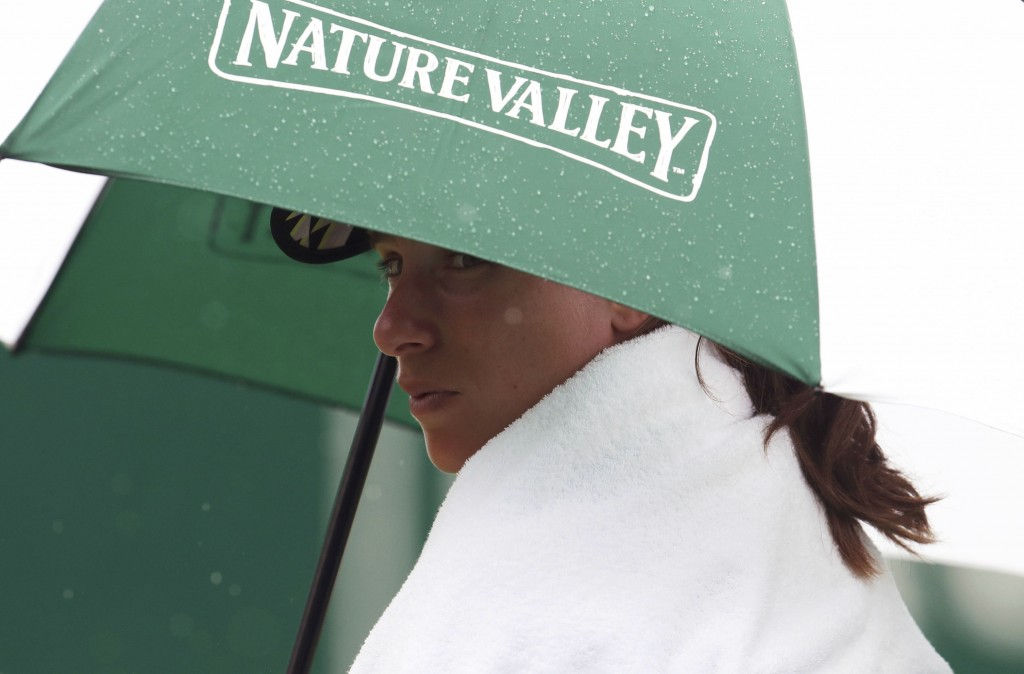 Johanna Konta sits under an umbrella before the Women's Singles match during day four of the Nature Valley International at Devonshire Park in Eastbou...