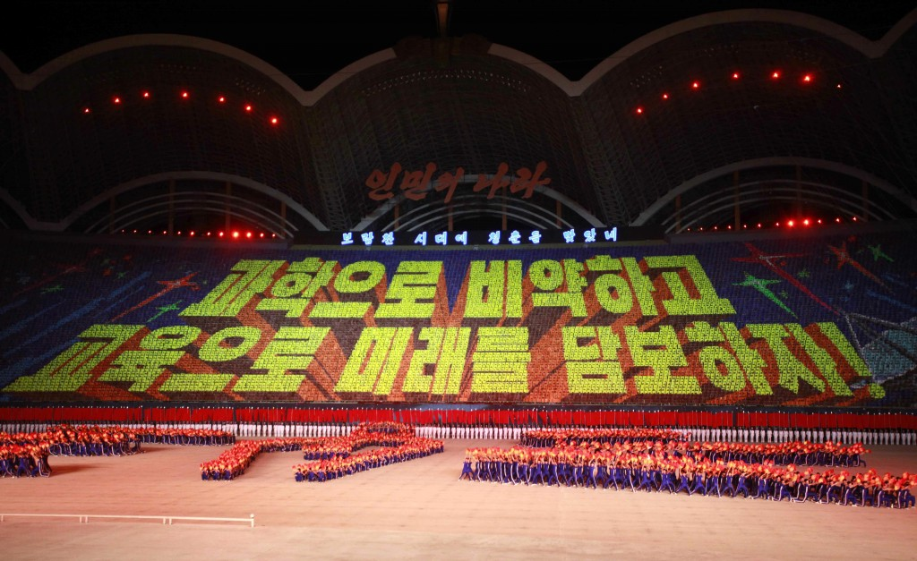 """North Koreans performs a mass game of """"The Land of the People"""" at the May Day Stadium in Pyongyang, North Korea, Tuesday, June 25, 2019. Cards formed ..."""