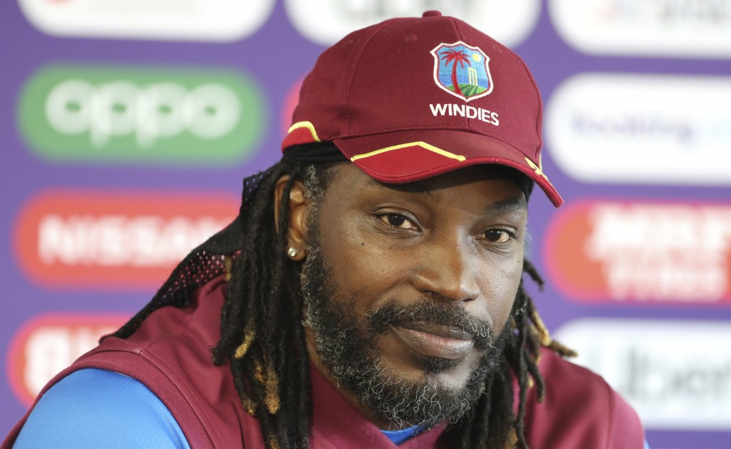 West Indies' Chris Gayle listens to a question from a journalist during a press conference after attending a training session ahead of their Cricket W...
