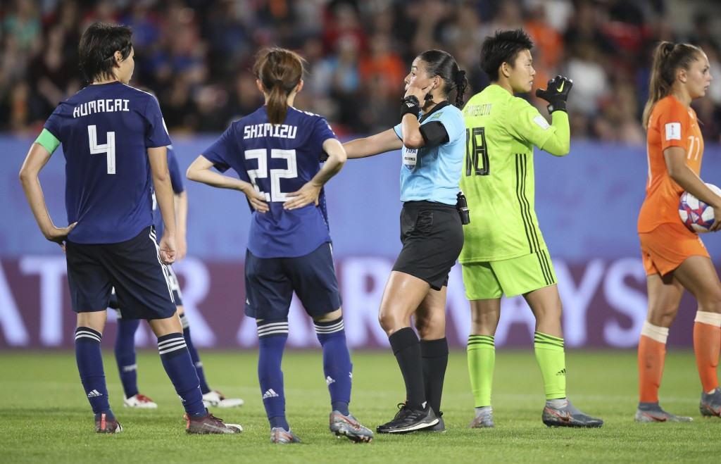 Referee Melissa Borjas, center, consults with VAR after awarding a penalty to the Dutch team during the Women's World Cup round of 16 soccer match bet...