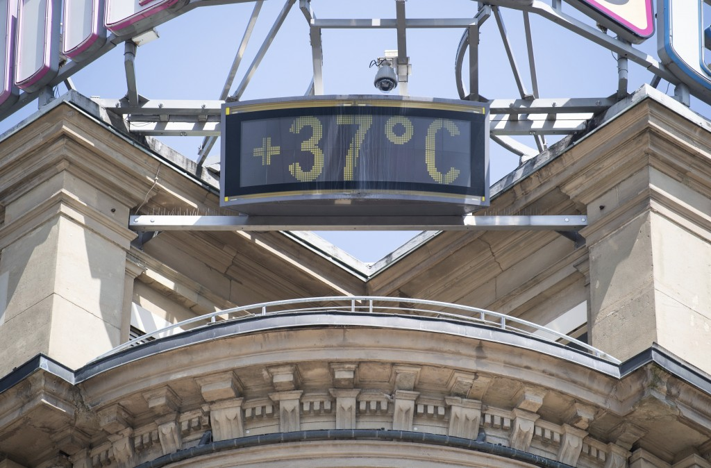 A sign shows 37 degrees Celsius at a building in the city of Stuttgart, Germany, Wednesday, June 26, 2019. Germany and Europe is hit by a heatwave wit...