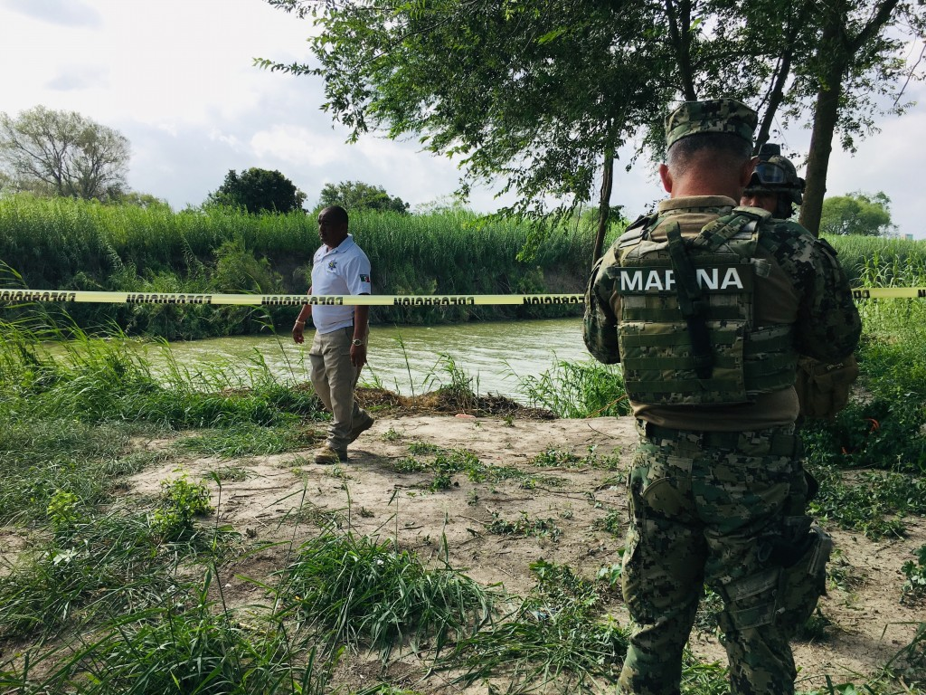 Mexican authorities walk along the Rio Grande bank where the bodies of Salvadoran migrant Oscar Alberto Martínez Ramírez and his nearly 2-year-old dau...
