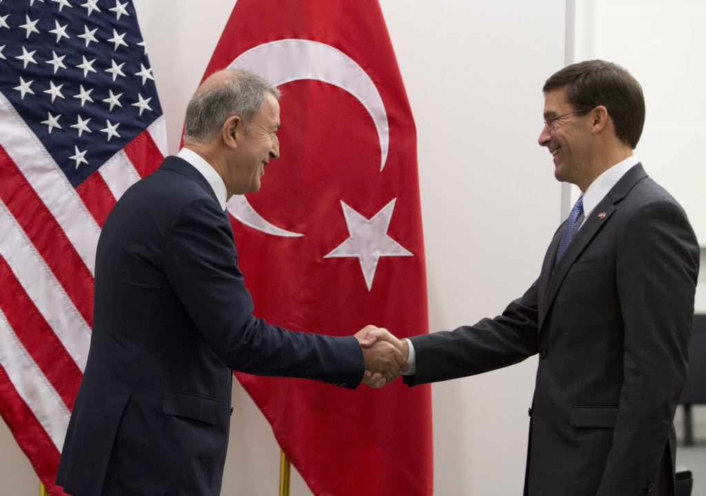Acting U.S. Secretary for Defense Mark Esper, right, greets Turkish Defense Minister Hulusi Akar prior to a meeting of NATO defense ministers at NATO ...