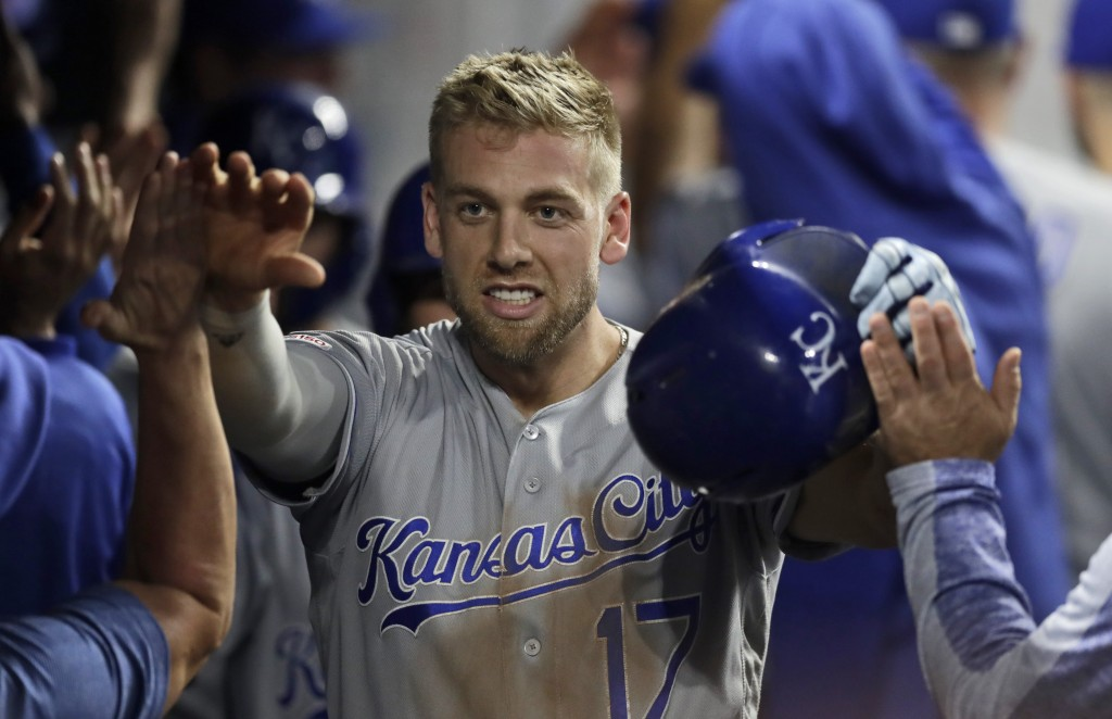 Kansas City Royals' Hunter Dozier is congratulated by teammates after hitting a grand slam in the ninth inning of a baseball game against the Clevelan...