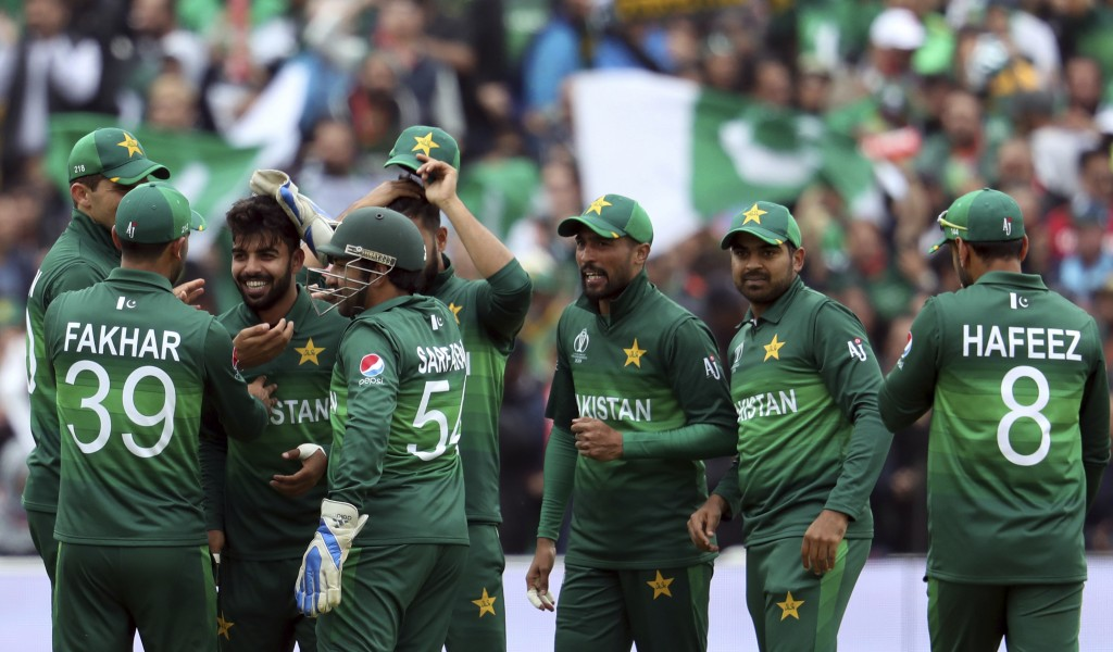 Pakistan's bowler Shadab Khan, third from left, celebrates with teammates after dismissing New Zealand's captain Kane Williamson for 41 run during the...