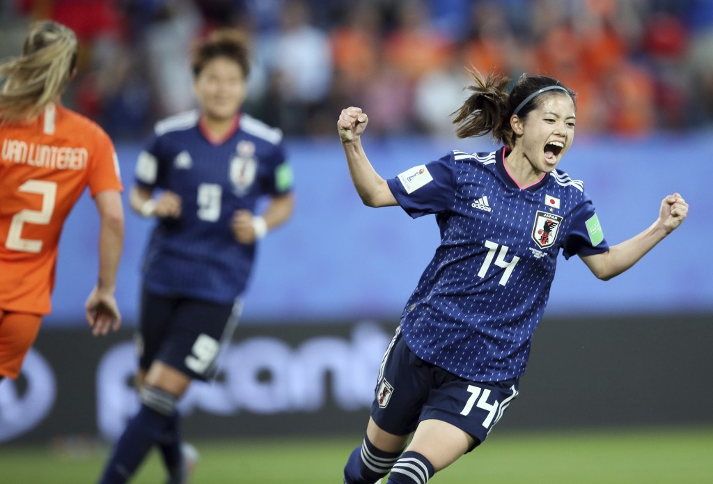 Japan's Yui Hasegawa celebrates after scoring her side's first goal during the Women's World Cup round of 16 soccer match between the Netherlands and ...