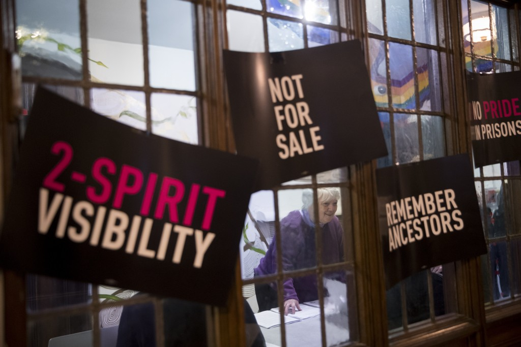 In this Wednesday, March 27, 2019, photo, a participant checks in as she arrives for a meeting of the Reclaim Pride Coalition at the Church of the Vil...