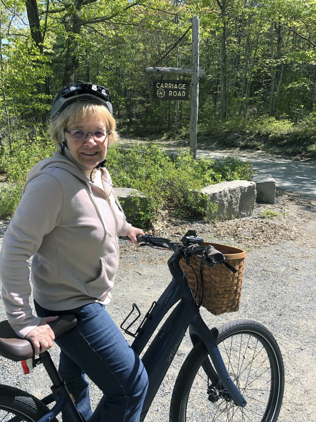 In this June 8, 2019 photo, Janice Goodwin stops her electric-assist bicycle gate near a carriage path in Acadia National Park at Bar Harbor, Maine. E...