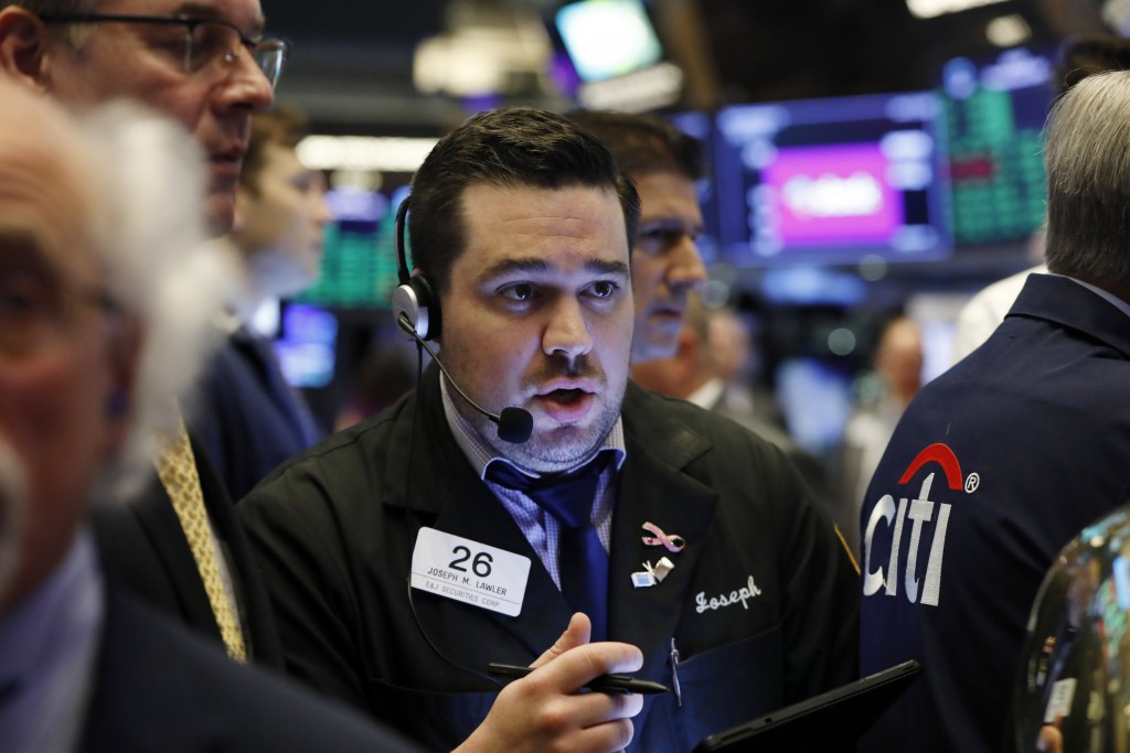 FILE - In this June 20, 2019, file photo trader Joseph Lawler works on the floor of the New York Stock Exchange. The U.S. stock market opens at 9:30 a...