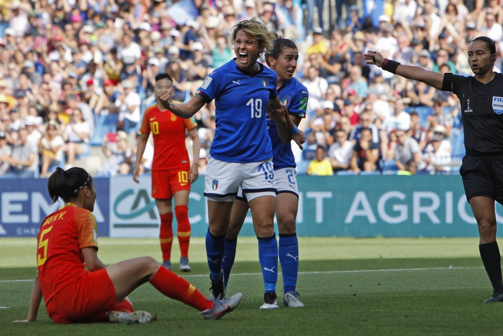 Italy's Valentina Giacinti, center, celebrates after scoring her side's first goal during the Women's World Cup round of 16 soccer match between Italy...