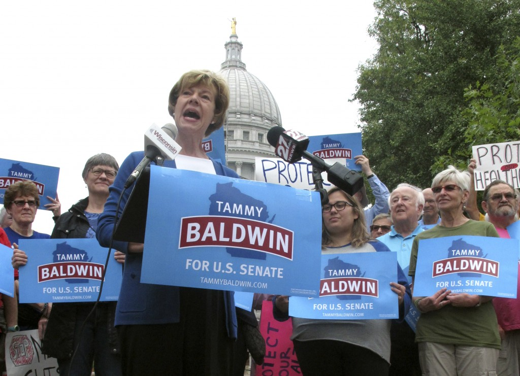 FILE - In this Sept. 20, 2018 file photo, U.S. Sen. Tammy Baldwin, D-Wis. speaks to supporters and talks about her support for the national health car...