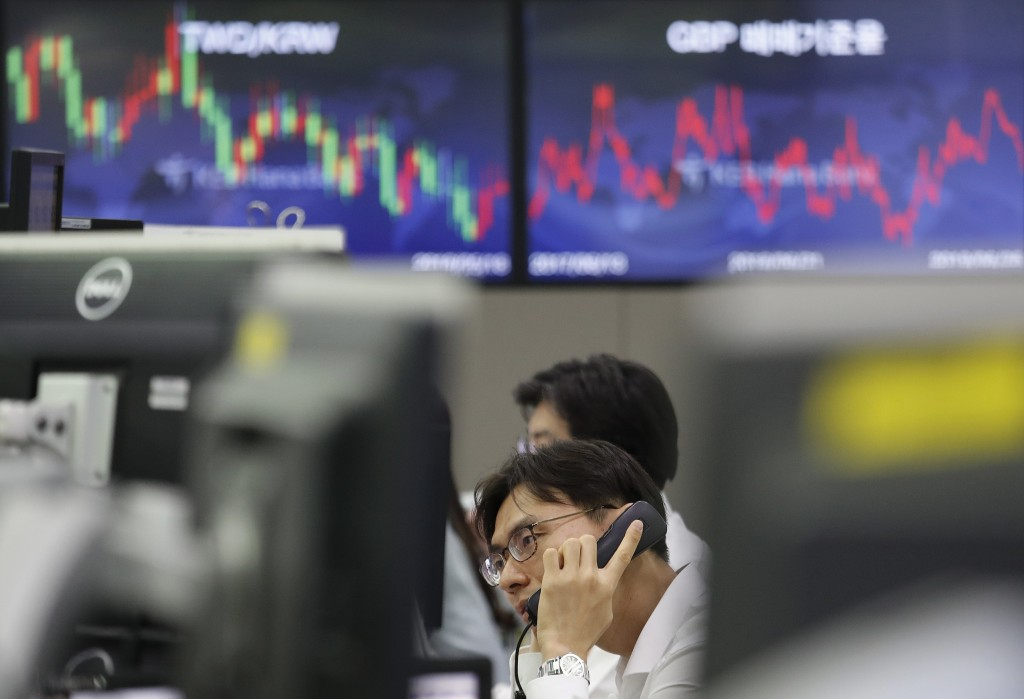 A currency trader talks on phone at the foreign exchange dealing room of the KEB Hana Bank headquarters in Seoul, South Korea, Wednesday, June 26, 201...
