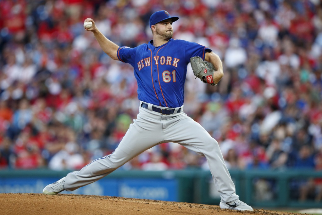 New York Mets' Walker Lockett pitches during the third inning of the team's baseball game against the Philadelphia Phillies, Tuesday, June 25, 2019, i...