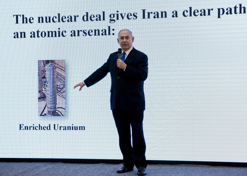 FILE - In this April 30 2018 file photo, Israeli Prime Minister Benjamin Netanyahu presents material on Iranian nuclear weapons development during a p...