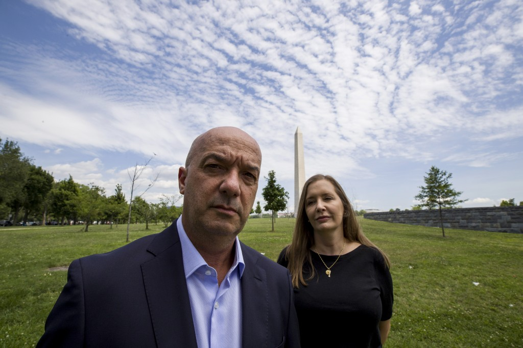 In this June 24, 2019, photo, former Venezuelan police commissioner Ivan Simonovis poses for a photograph with his wife Bony Pertnez in Washington. In...