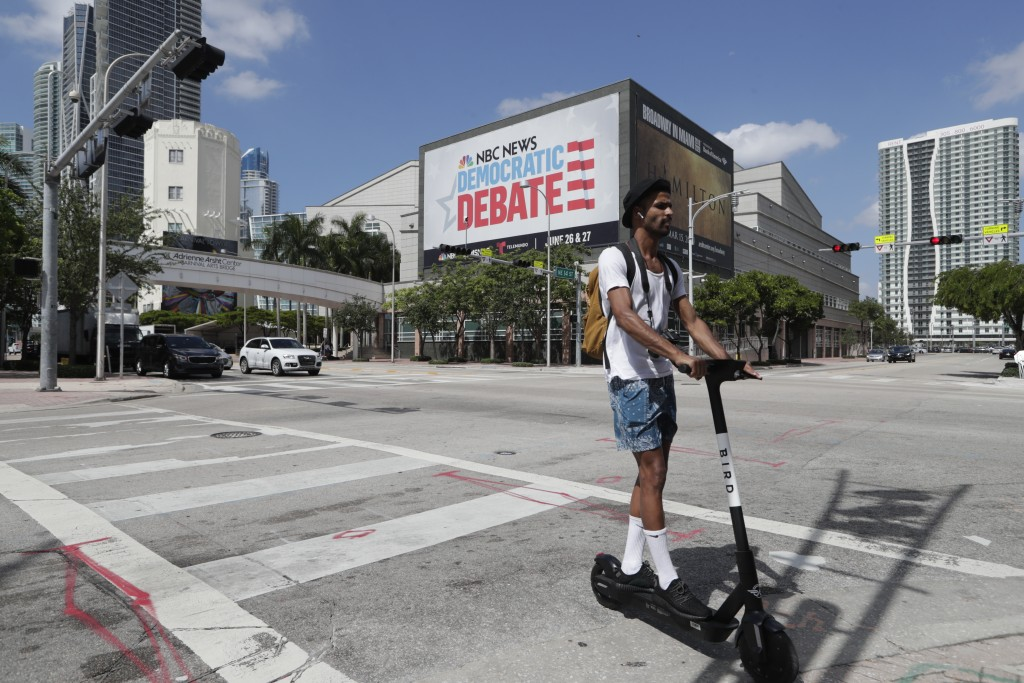 A billboard advertises the Democratic presidential debates across from the Knight Concert Hall at the Adrienne Arsht Center for the Performing Arts Mo...