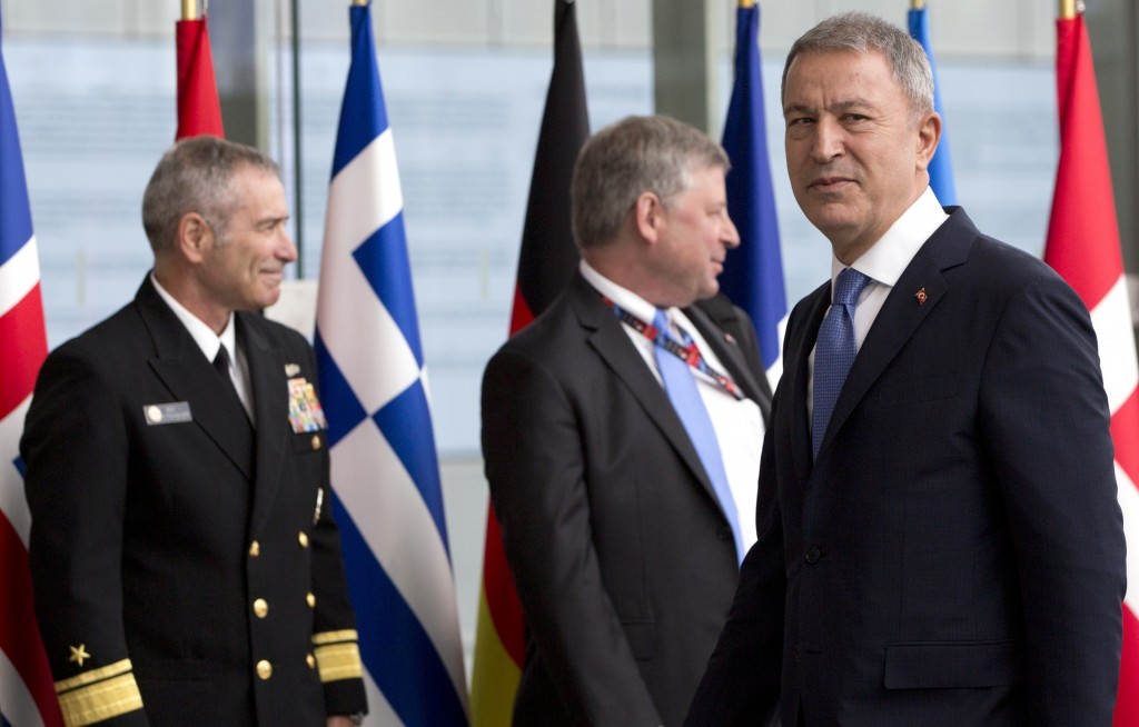 Turkish Defense Minister Hulusi Akar, right, arrives for a meeting of NATO defense ministers at NATO headquarters in Brussels, Wednesday, June 26, 201...