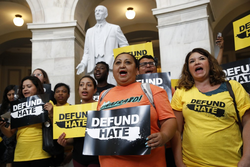 Protesters gather to demand the defunding of government agencies for border protection and customs enforcement, Tuesday, June 25, 2019, on Capitol Hil...