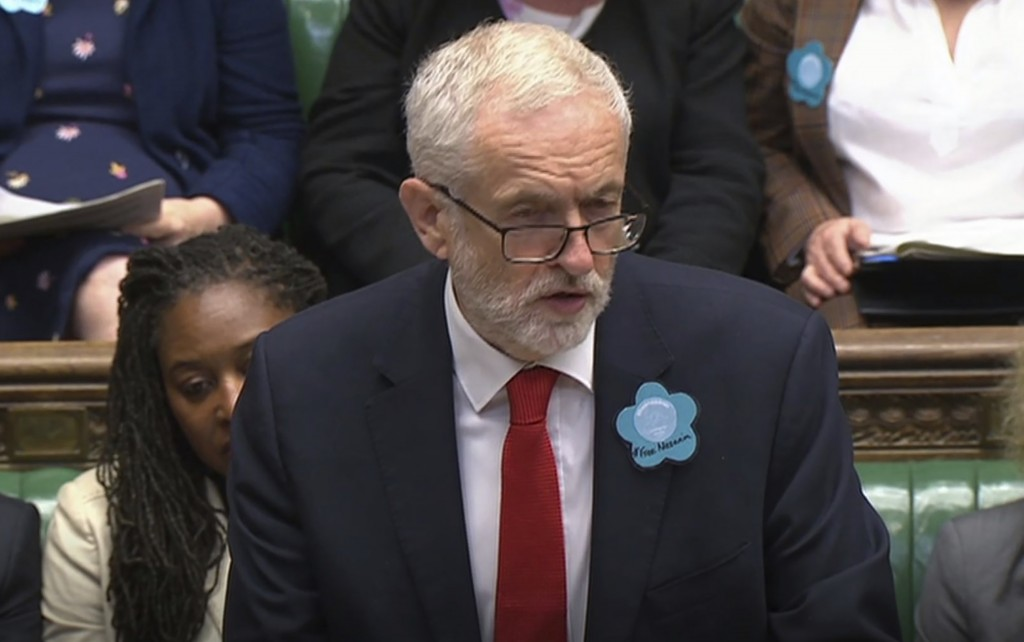 """Britain's main opposition Labour Party leader Jeremy Corbyn wears a """"Free Nazanin"""" badge as he speaks during Prime Minister's Questions session at the"""