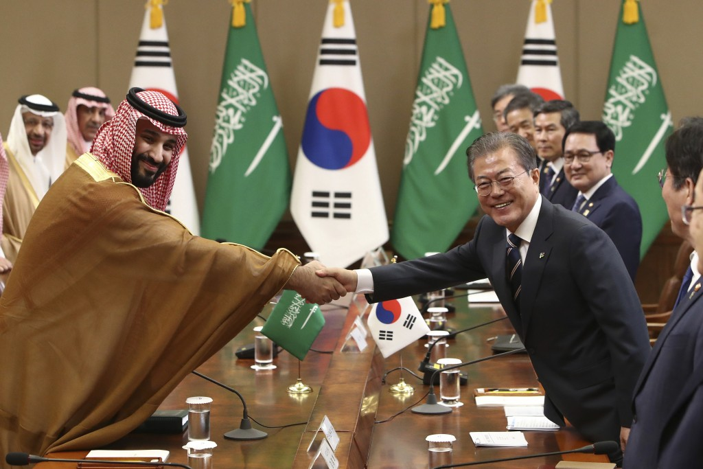 South Korean President Moon Jae-in, right, shakes hands with Saudi Crown Prince Mohammed bin Salman during a meeting at the presidential Blue House, W...