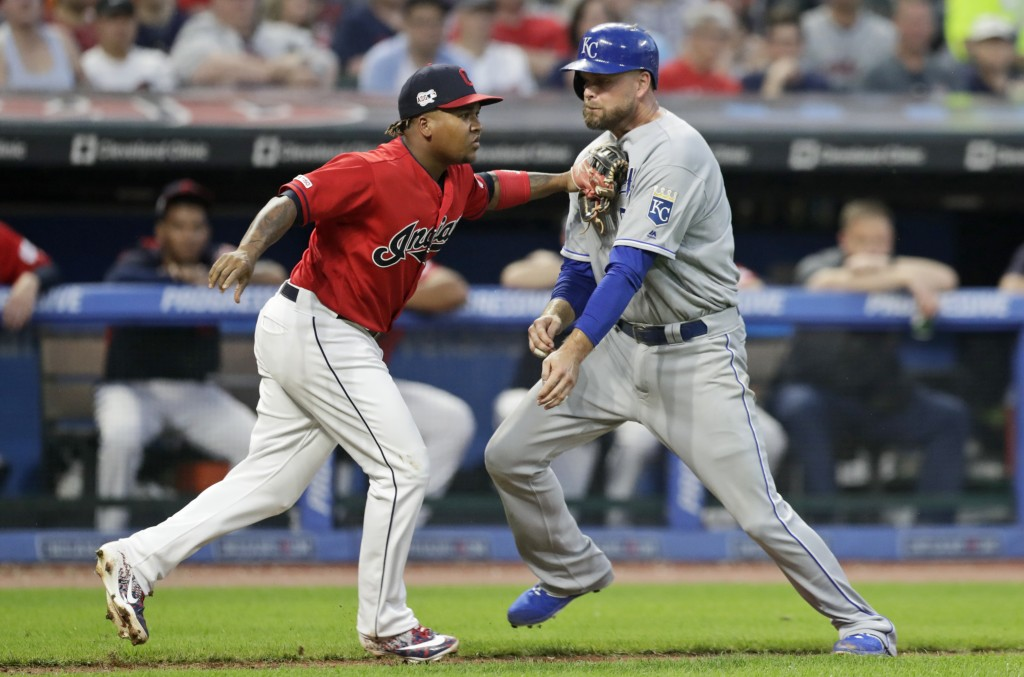 Kansas City Royals' Lucas Duda, right, is tagged out by Cleveland Indians' Jose Ramirez in a rundown at home in the sixth inning in a baseball game, T...