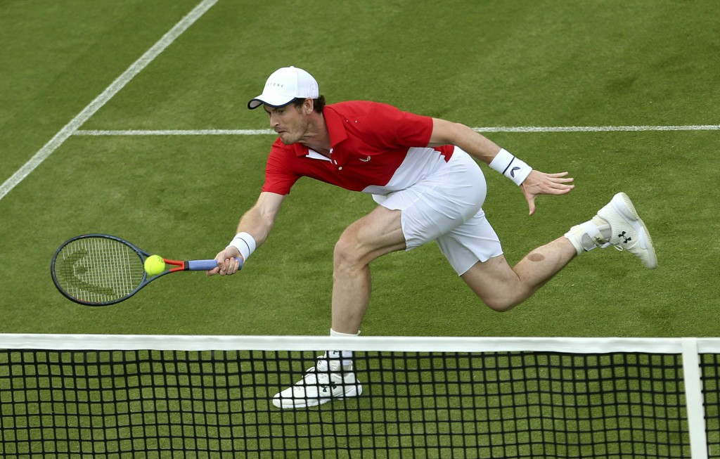Britain's Andy Murray in action in his Men's Doubles tennis match with partner Brazil's Marcelo Melo against Juan Sebastian Cabal and Robert Farah of ...