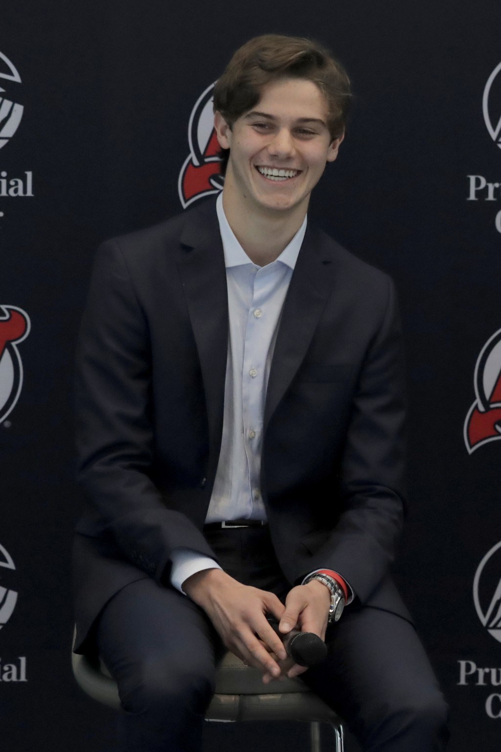 New Jersey Devils forward Jack Hughes, the No. 1 overall pick in the 2019 NHL hockey draft, reacts during a news conference introducing the prospect t...
