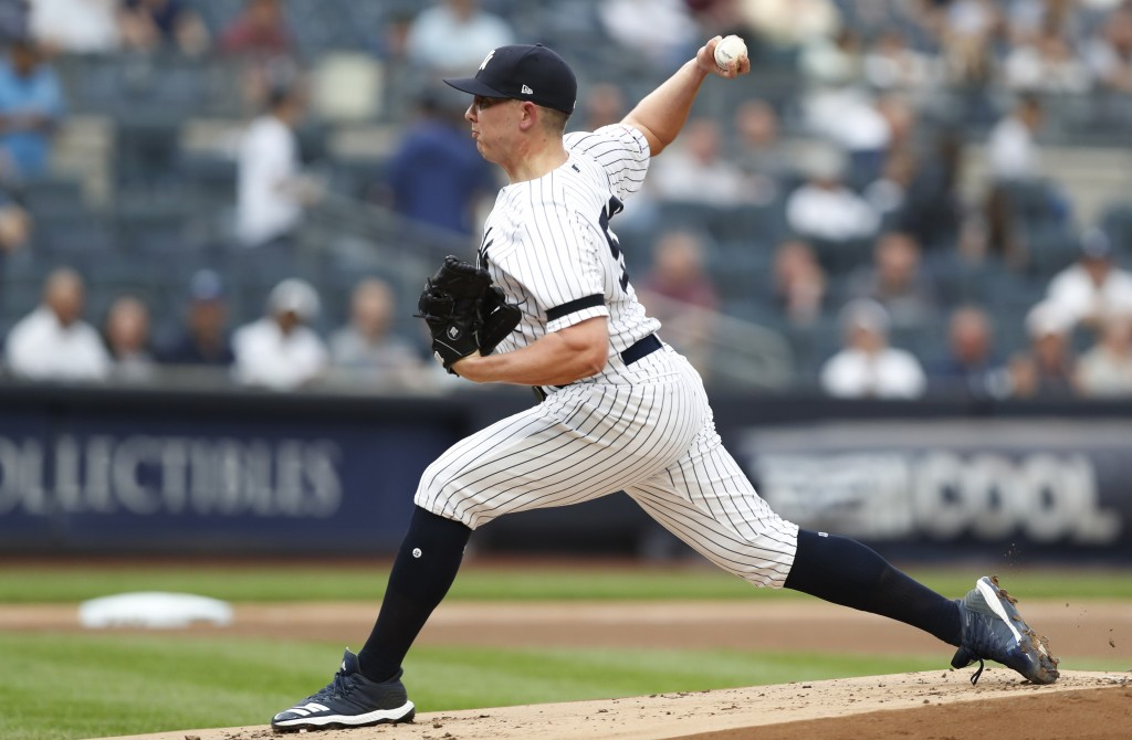 New York Yankees starting pitcher Chad Green winds up during the first inning of the team's baseball game against the Toronto Blue Jays, Tuesday, June...