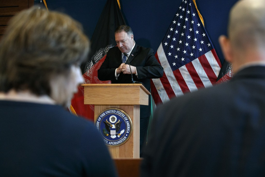 Secretary of State Mike Pompeo leaves the podium after a news conference at U.S. Embassy Kabul, Tuesday, June 25, 2019, during an unannounced visit to...