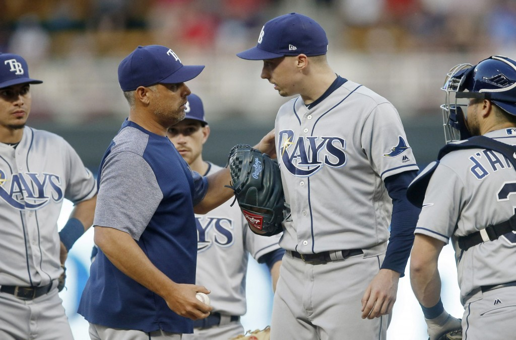 Tampa Bay Rays manager Kevin Cash, left, pulls starting pitcher Blake Snell, right, in the fourth inning of a baseball game, Tuesday, June 25, 2019, i...