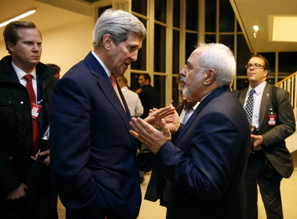 FILE - In this Jan. 16, 2016 file photo, Secretary of State John Kerry talks with Iranian Foreign Minister Mohammad Javad Zarif in Vienna, after the I...