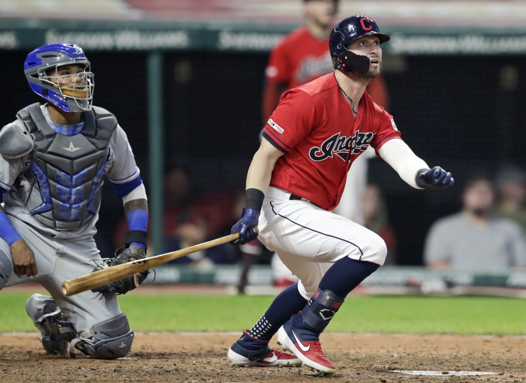Cleveland Indians' Tyler Naquin, right, watches the ball after hitting a two-run home run in the sixth inning of a baseball game, Tuesday, June 25, 20...