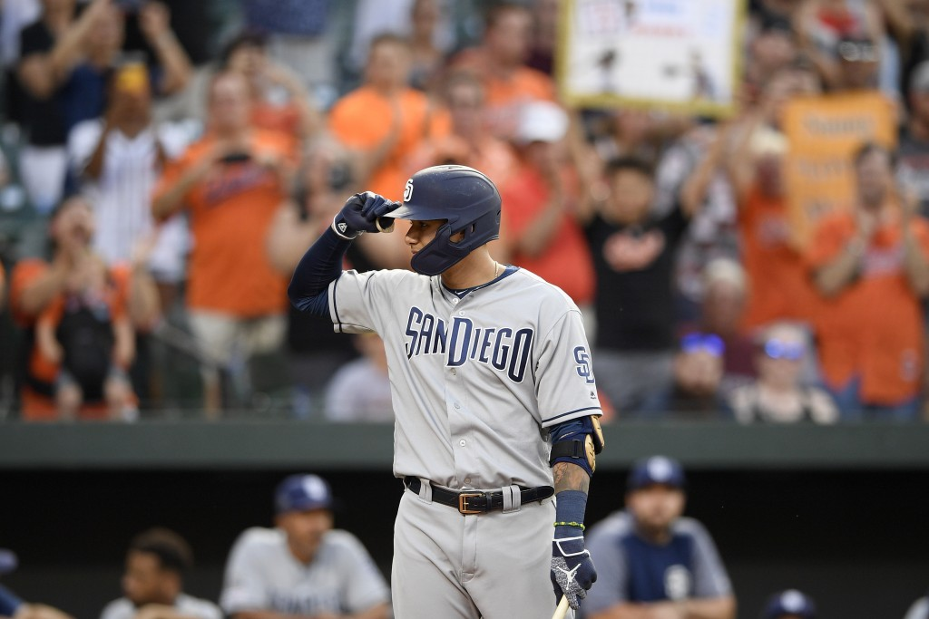 San Diego Padres' Manny Machado acknowledges the crowd during the first inning of a baseball game against his former team, the Baltimore Orioles, Tues...