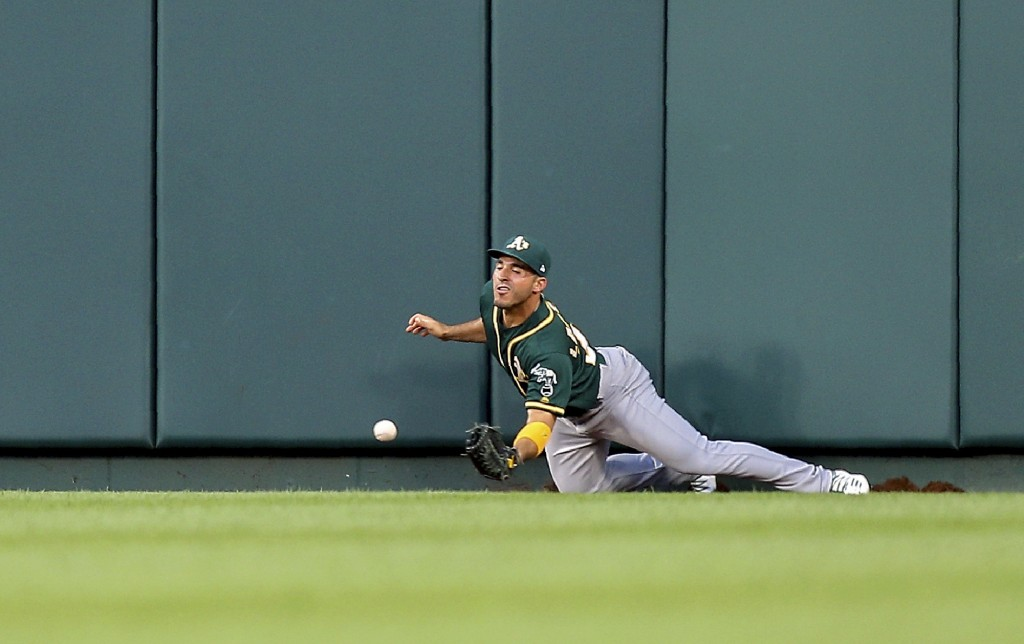 Oakland Athletics center fielder Ramon Laureano is unable to make a catch resulting in a two-run triple by St. Louis Cardinals' Matt Carpenter during ...