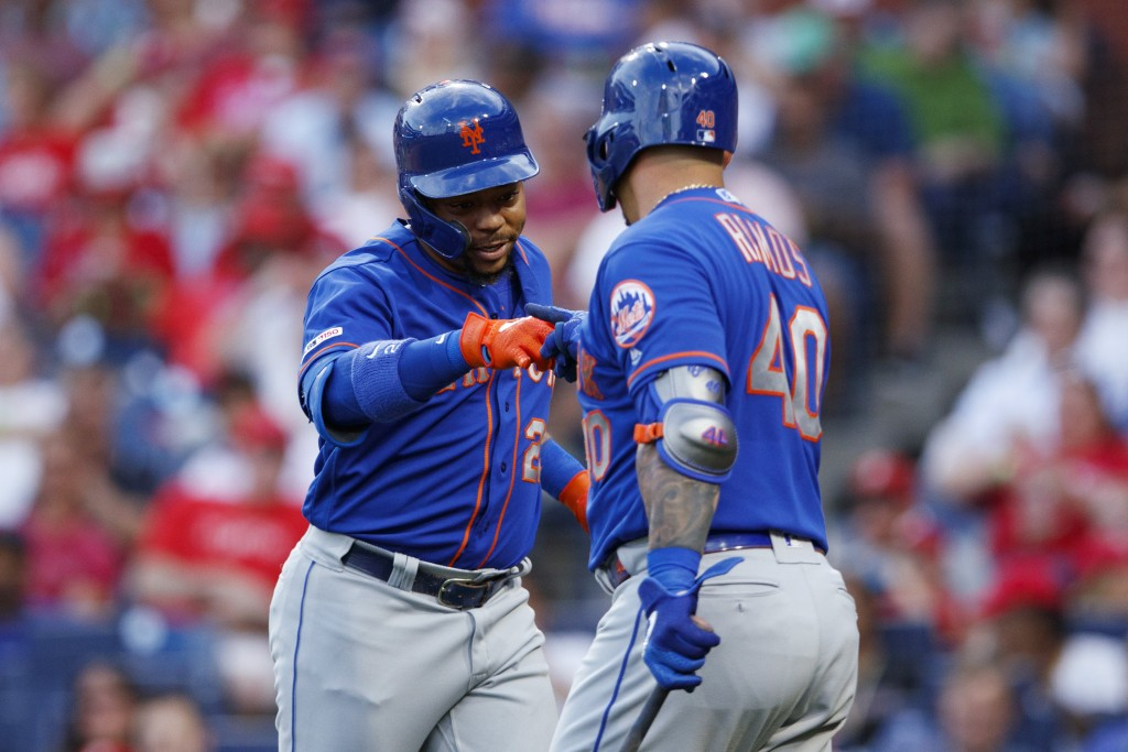 New York Mets' Dominic Smith, left, and Wilson Ramos celebrate after Smith's home run during the third inning of a baseball game against the Philadelp...