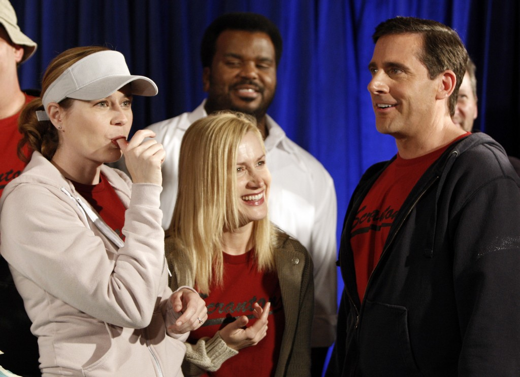 FILE - In this April 14, 2009, file photo cast members, from left, Jenna Fischer, Angela Kinsey, Craig Robinson, and Steve Carell are seen after cutti...
