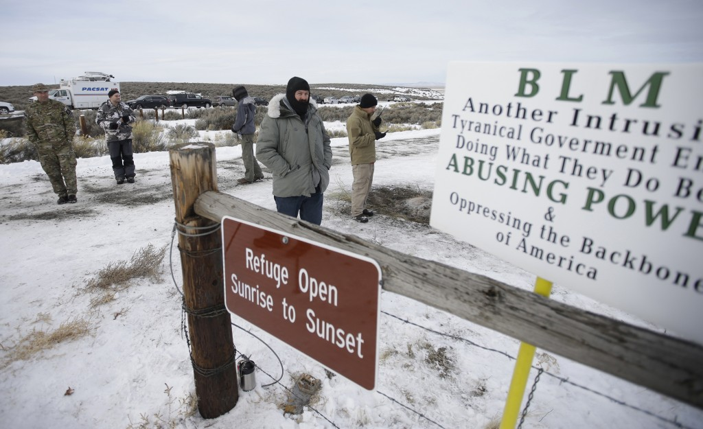 FILE - In this Monday, Jan. 4, 2016, file photo, members of the group occupying the Malheur National Wildlife Refuge headquarters stand guard near Bur...