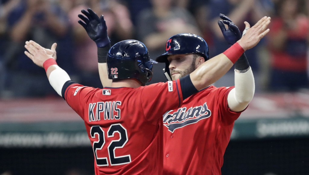 Cleveland Indians' Tyler Naquin, right, celebrates with Jason Kipnis after Naquin hit a two-run home run in the sixth inning of a baseball game agains...