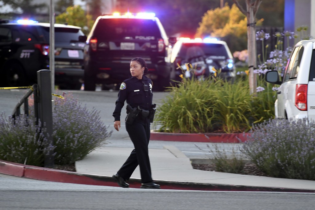 Police investigate at the scene of a shooting at the Morgan Hill Ford Store in Morgan Hill, Calif., Tuesday, June 25, 2019. Police say the shooting ha...