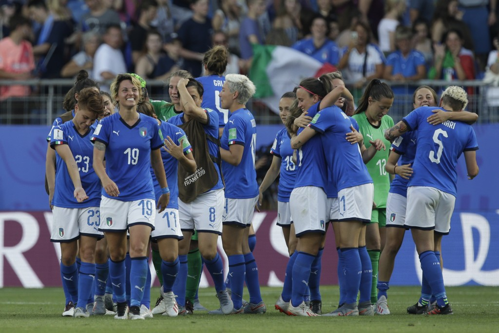 Italy players celebrate at the end of the Women's World Cup round of 16 soccer match between Italy and China at Stade de la Mosson in Montpellier, Fra...