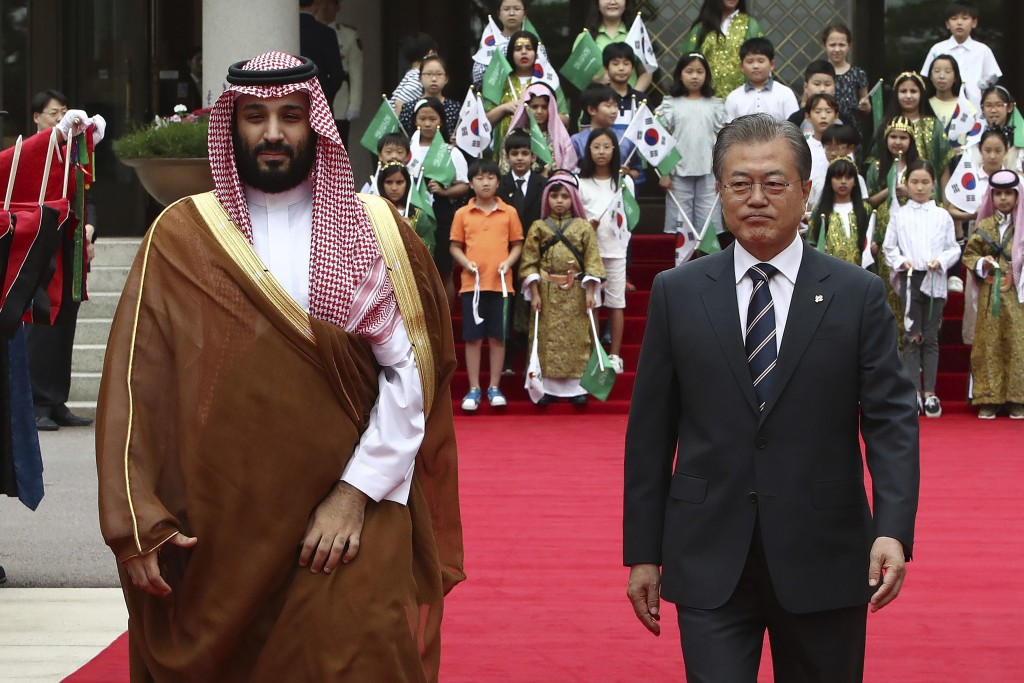 South Korean President Moon Jae-In, right, and Saudi Crown Prince Mohammed bin Salman walk to view an honor guard during a welcoming ceremony at the p...
