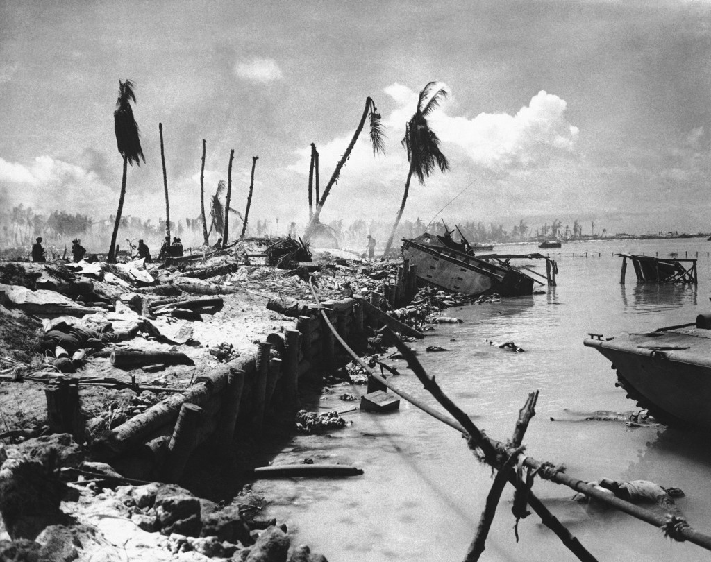FILE - In this November 1943 file photo, bodies and wrecked amphibious tractors litter a battlefield, after U.S. Marines from the 2nd Division forced ...