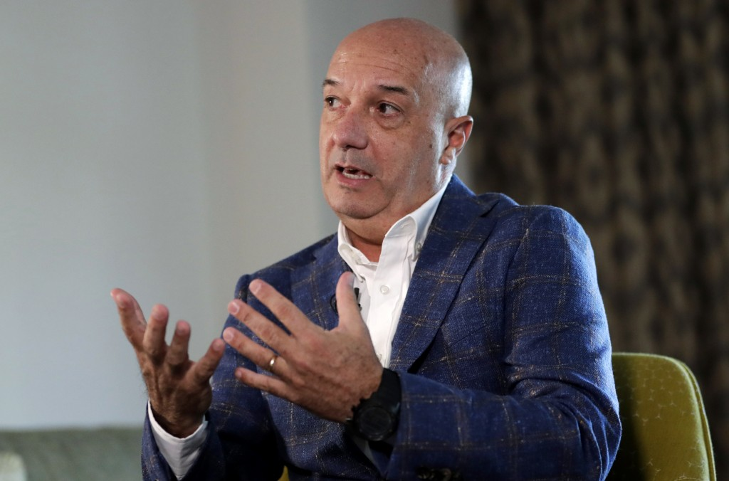 In this Sunday, June 23, 2019 photo, Ivan Simonovis responds to a question during a interview with The Associated Press, in Miami. In his first interv...