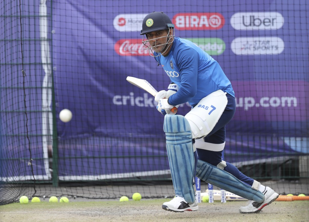 India's MS Dhoni bats in the nets during a training session ahead of their Cricket World Cup match against West Indies at Old Trafford in Manchester, ...