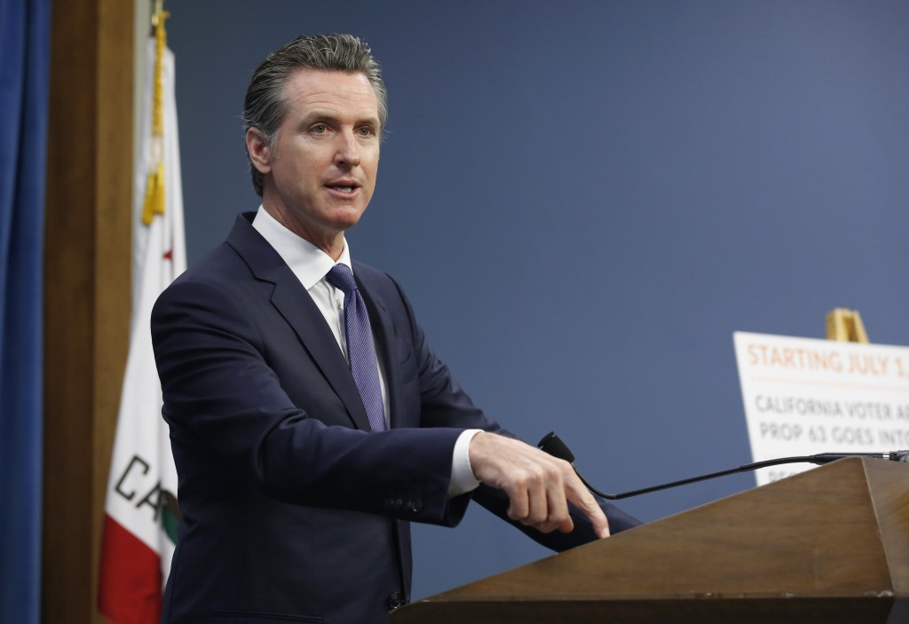 Gov. Gavin Newsom discusses a 2016 voter-approved ballot initiative that will require Californians to undergo criminal background checks every time th