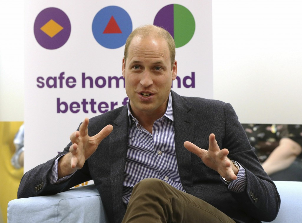 Britain's Prince William, the Duke of Cambridge, speaks to former and current service users during a visit to the Albert Kennedy Trust to learn about ...