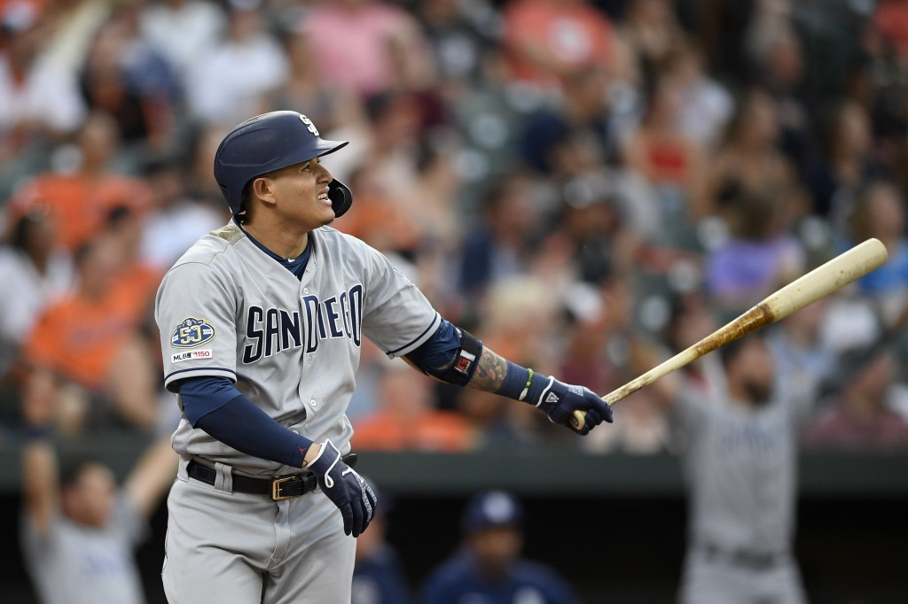 San Diego Padres' Manny Machado watches his home run during the third inning of a baseball game against the Baltimore Orioles, Tuesday, June 25, 2019,...