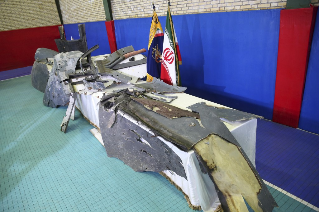 FILE - In this Friday, June 21, 2019 file photo, debris from what Iran's Revolutionary Guard aerospace division describes as the U.S. drone which was ...